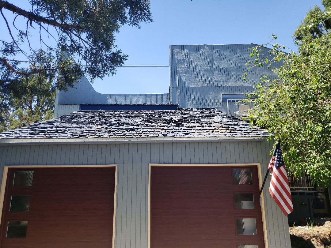 Bend, OR - Replacing the worn shake roof with standing seam metal.
