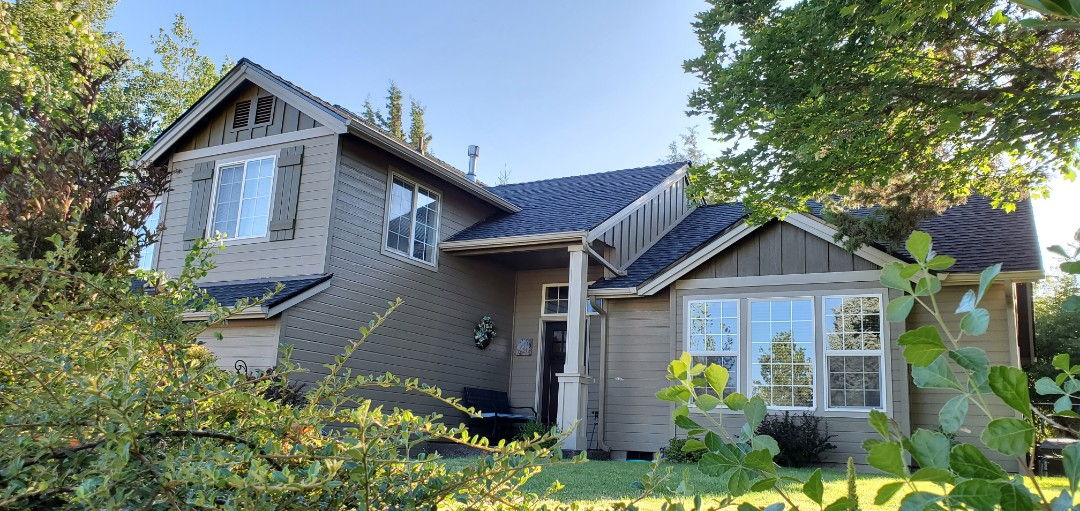 Redmond, OR - Just finished replacing a composition shingle roof with beautiful GAF Timberline Ultra HD shingles in Charcoal color. This roof includes an extended 50-year manufacturer's warranty against defects and a 10-year labor warranty from Deschutes Roofing