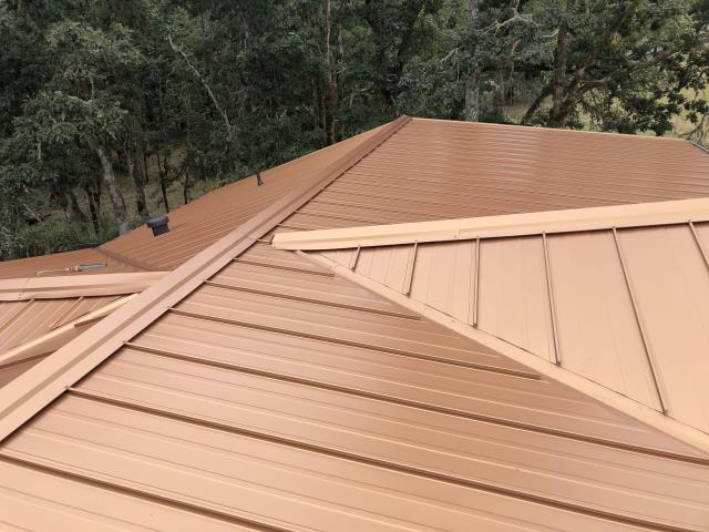 Eugene, OR - Another beautiful installation by Deschutes Roofing Company using Holly Panel metal roofing in the color Copper Penny.