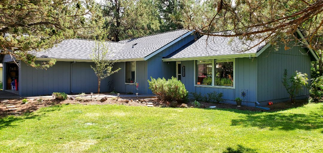 Bend, OR - Recently installed a new asphalt shingle roof in Bend using GAF Timberline HDZ architectural style shingles in Charcoal color. This roof includes continuous ridge vent and a 10-year labor warranty from Deschutes Roofing.
