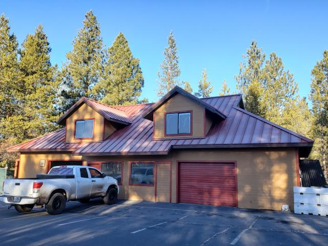 Sunriver, OR - Completed a new standing seam metal roof project in Sunriver with 24 gauge MS-150 in Tile Red.
