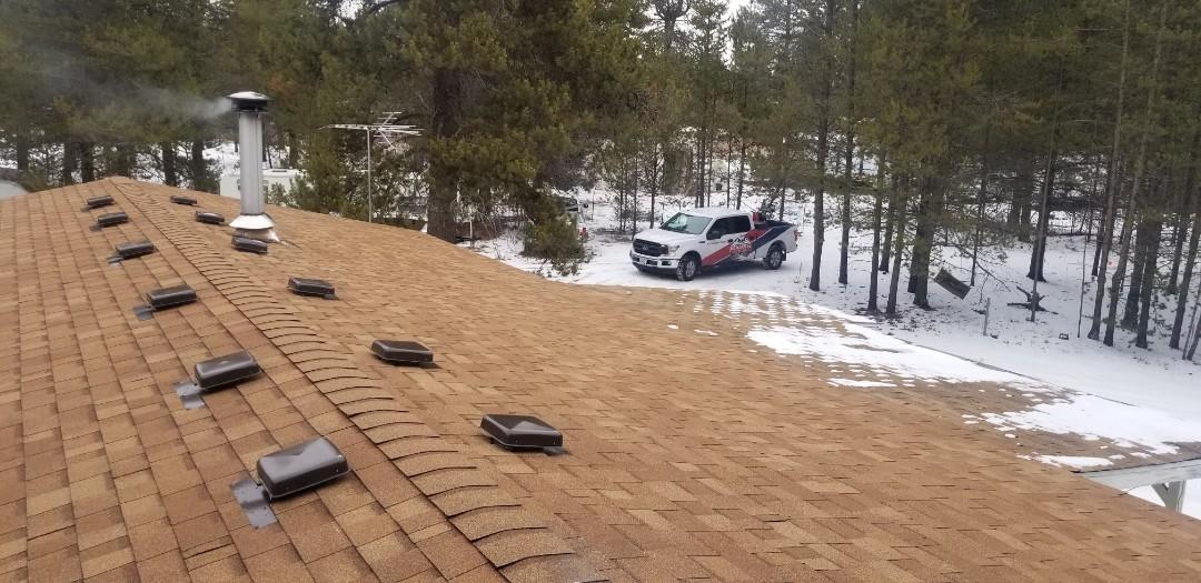 La Pine, OR - A beautiful re-roof by Deschutes Roofing Company using Owens Corning Oakridge Desert Tan shingles.