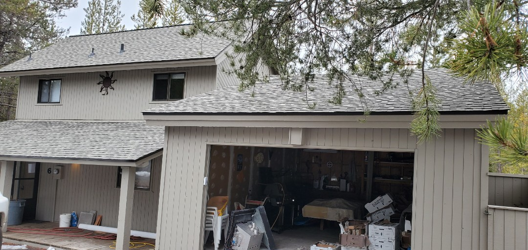 Sunriver, OR - Here's another beautiful roof replacement using GAF Timberline Ultra HD architectural shingles in Weathered Wood color. This new roof includes SnowCountry Advanced continuous ridge vent.