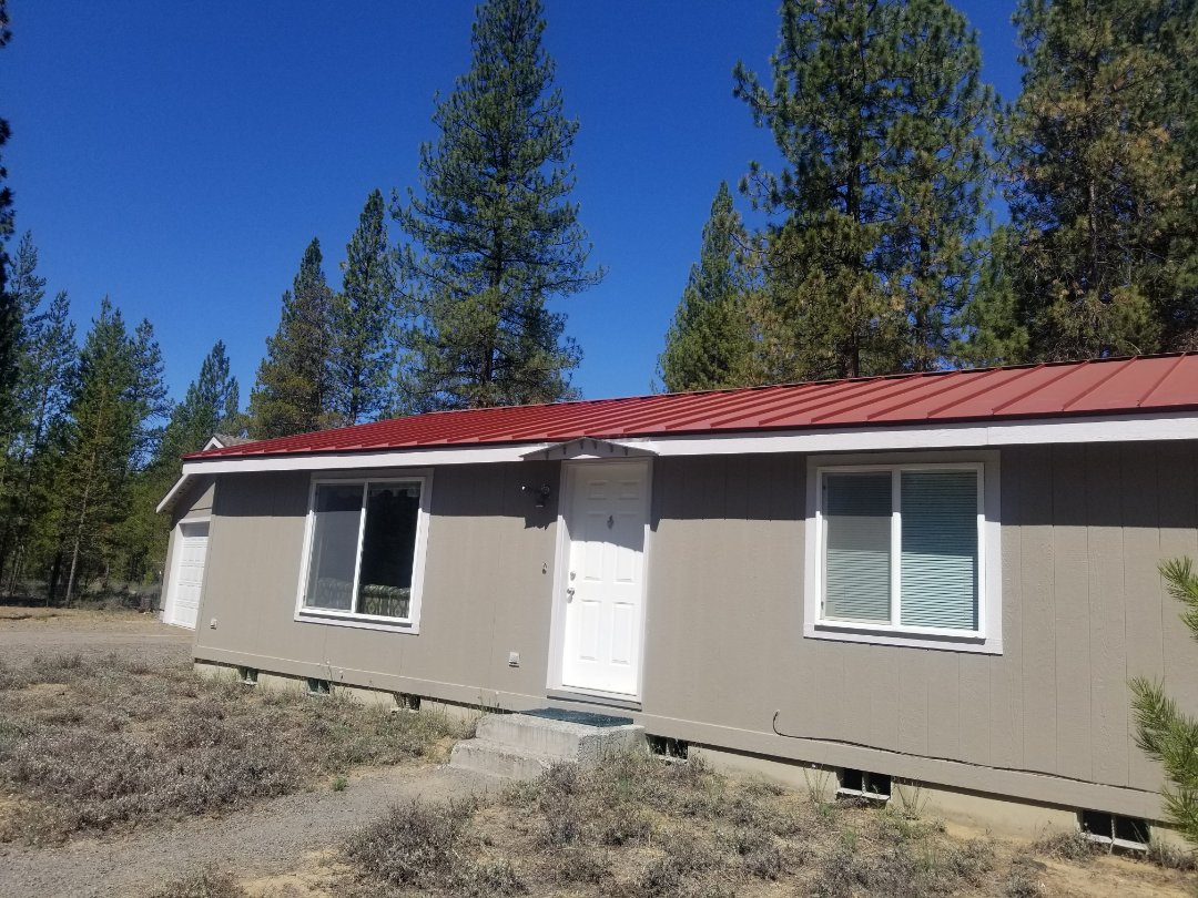 """La Pine, OR - Another beautiful installation by Deschutes roofing Company using 1�"""" standing seam metal Red."""