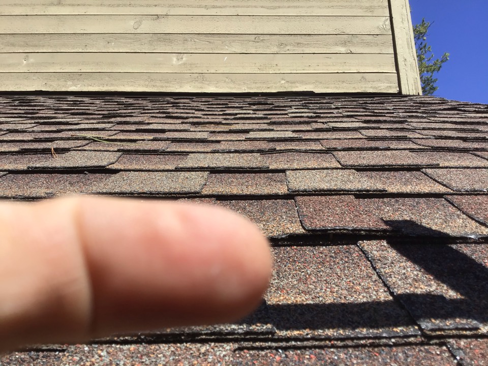Sunriver, OR - Repairing loose shingles and backed out nails