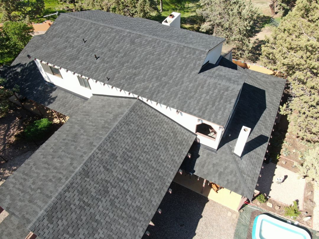 Redmond, OR - Another beautiful installation by Deschutes Roofing Company using GAF Grand Sequoia Charcoal.