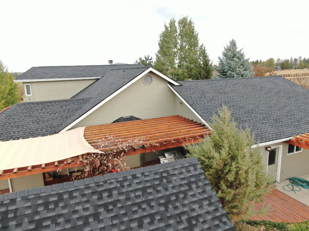 Bend, OR - This ranch need a new roof desperately. We installed  GAF Timberline HDZ Charcoal.