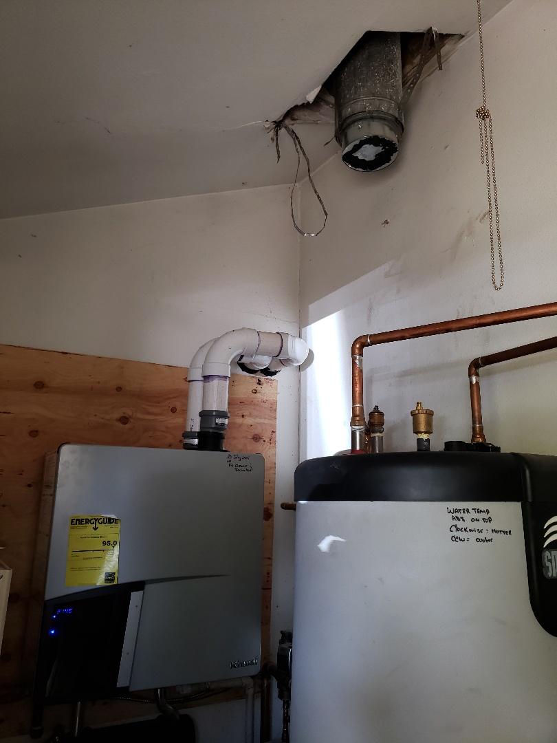 Boulder, CO - Relocate boiler flue