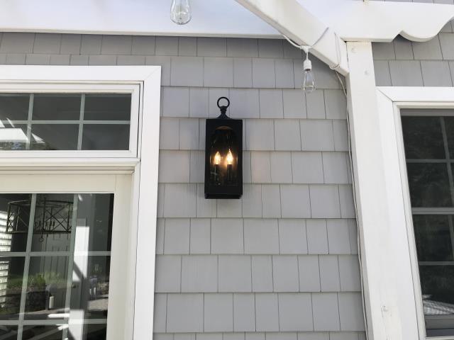 Install exterior lighting. Replace outside light. Install modern outdoor light.