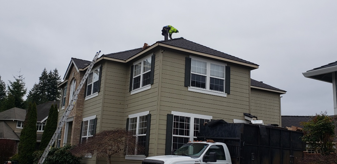 Mill Creek, WA - Finishing up the roof with new ridge cap.