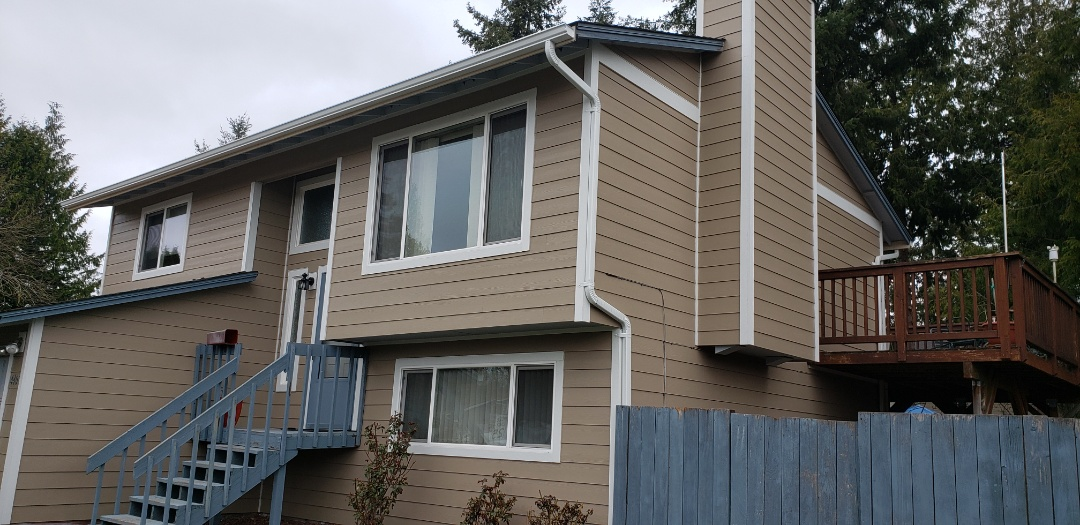 Lynnwood, WA - New James Hardie siding and gutters. Looking beautiful.