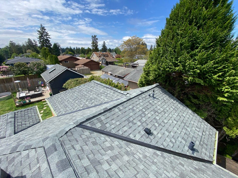 Burien, WA - Roof tie for previous customers addition.  It looks like it's always been here.