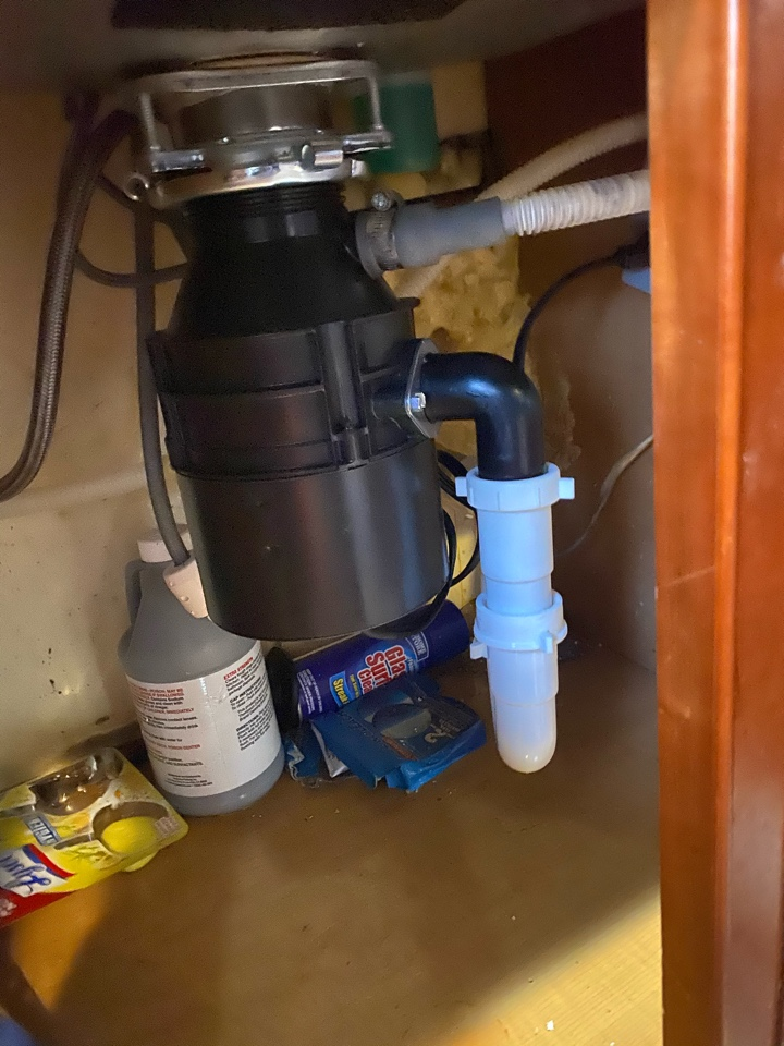 Snaked kitchen drain and installed new garbage disposal in Waldorf, MD
