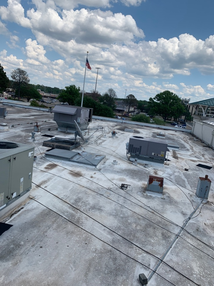 Working on some air-conditioning equipment on top of Broadway square mile mile