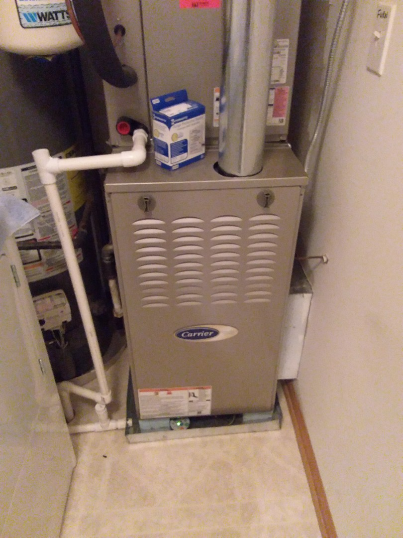 Orland Park, IL - Installing g furnace surge protector.