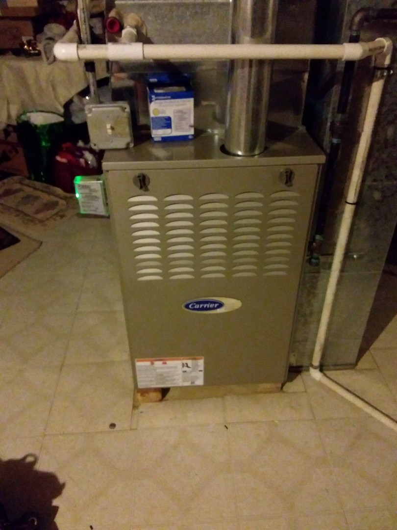 Aurora, IL - Install furnace surge protector on carrier furnace.