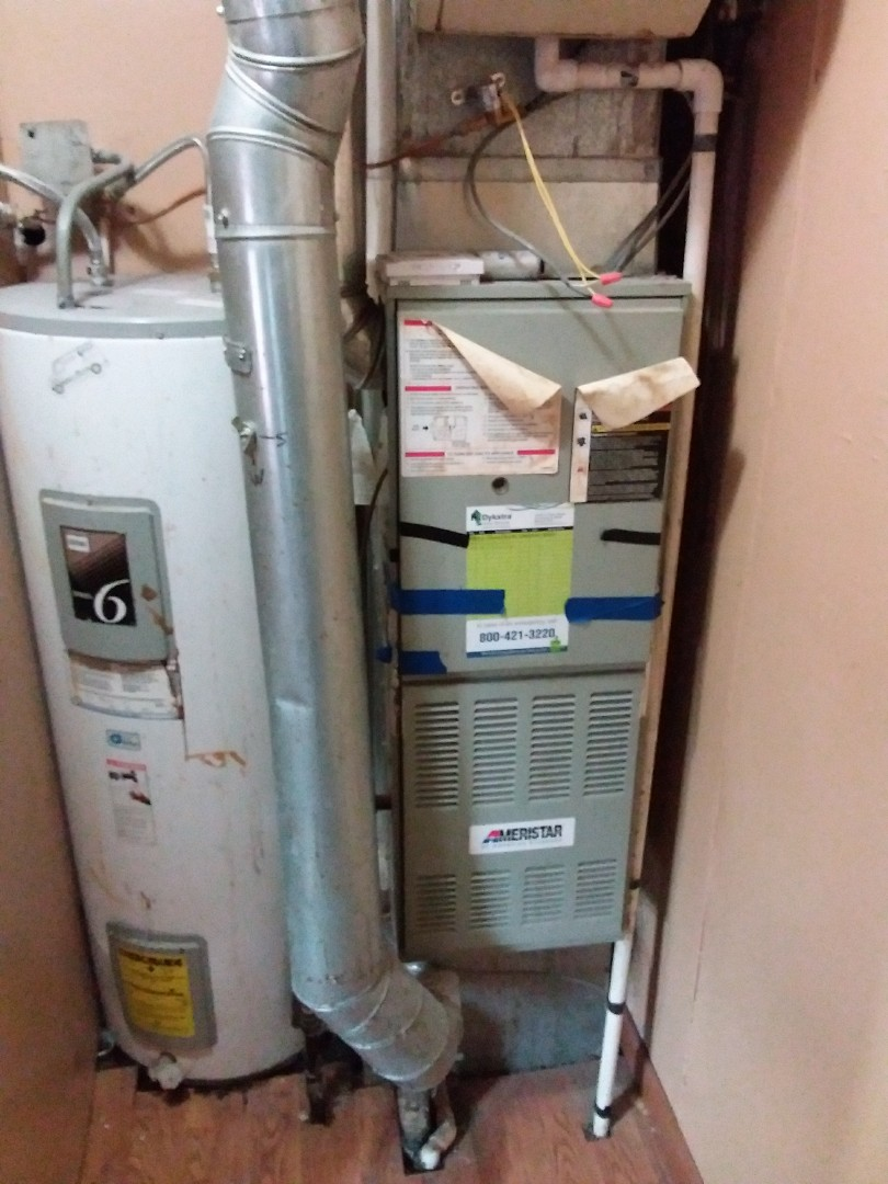 Chicago, IL - Installation of new carrier furnace replacing old American furnace