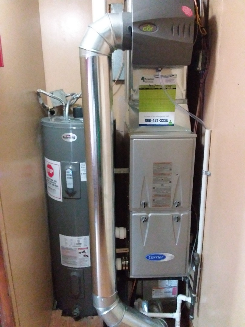 Chicago, IL - Installation of new carrier furnace replacing old comfort maker furnace