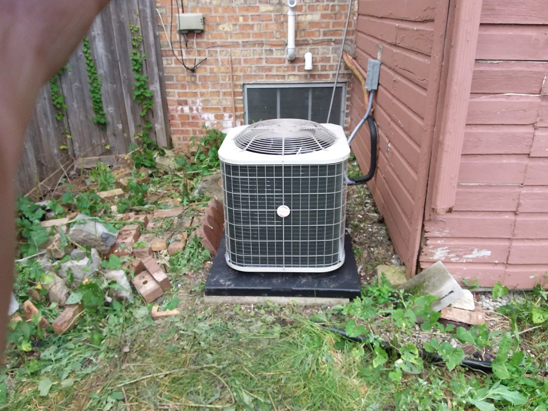 Chicago, IL - Installation of new Payne air conditioner replacing old ge air conditioner