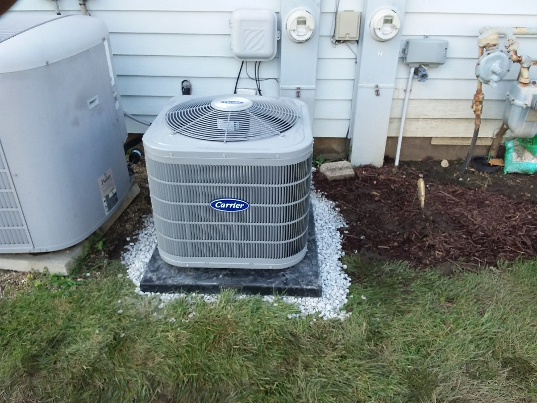 Woodridge, IL - Installation of new carrier air conditioner replacing old ge air conditioner