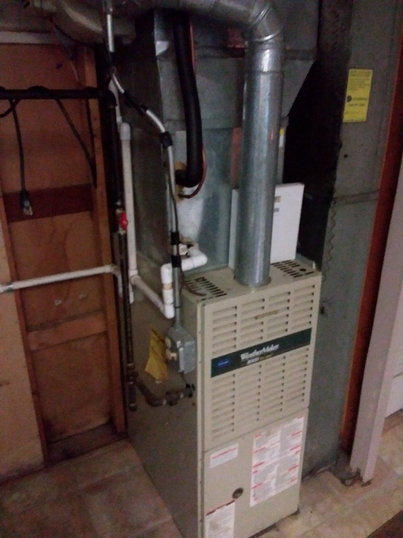 Chicago, IL - Installation of new carrier furnace replacing old carrier furnace
