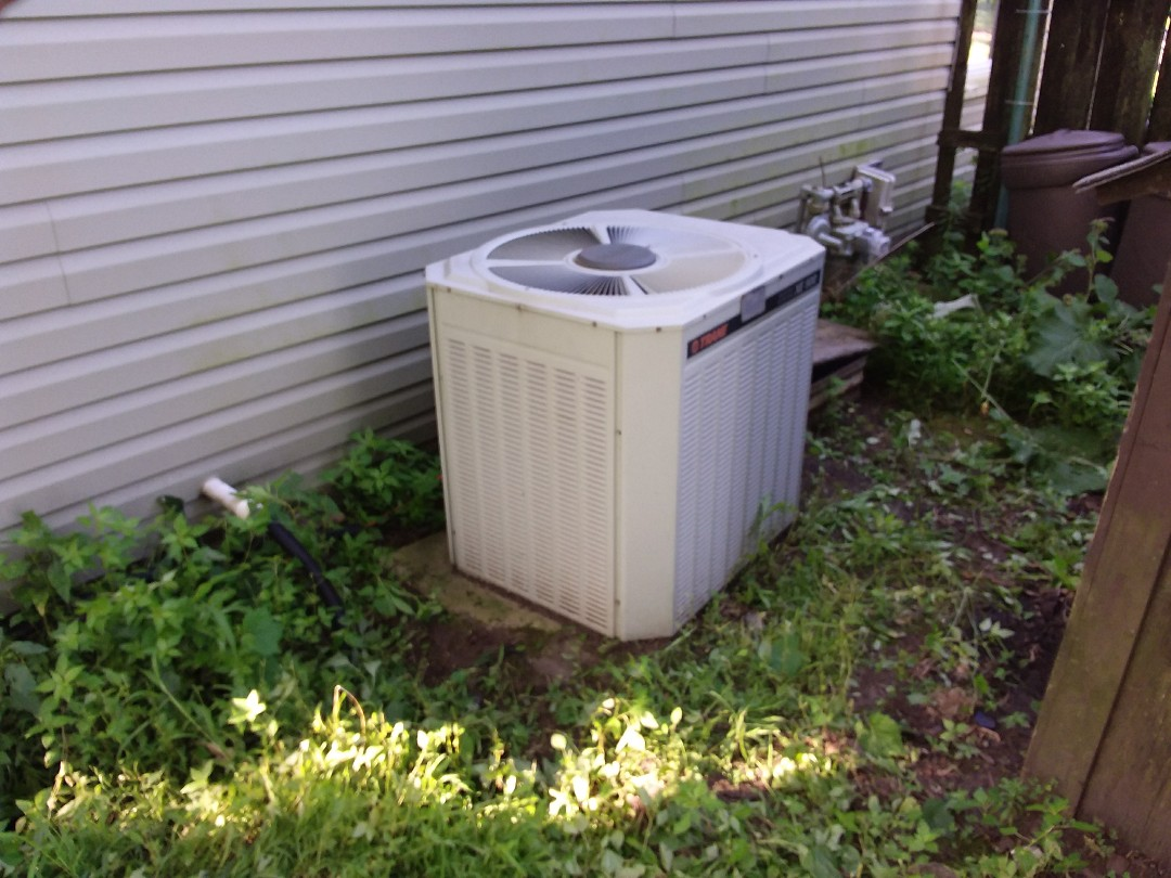 Wheaton, IL - Installation of new carrier air conditioner replacing old ge air conditioner