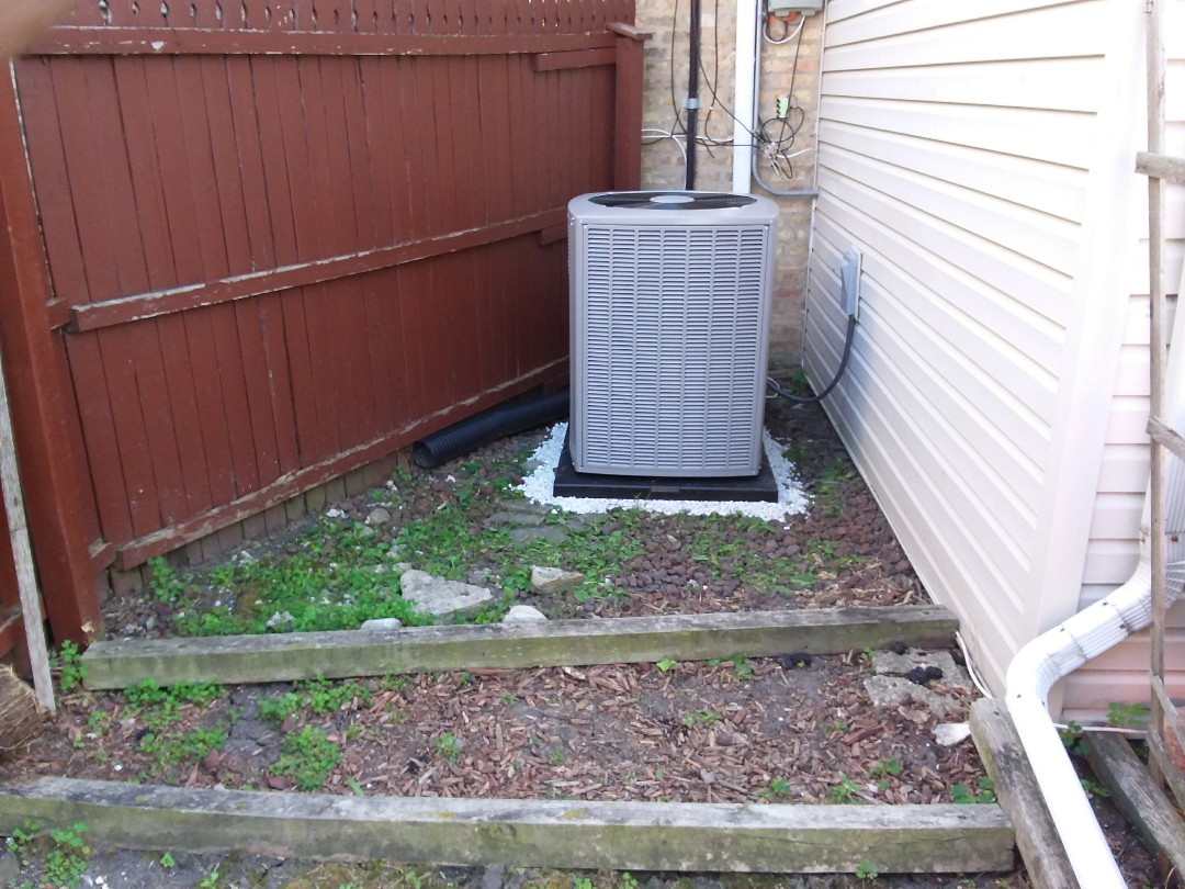 Elmwood Park, IL - Installation of new carrier air conditioner replacing old ge air conditioner