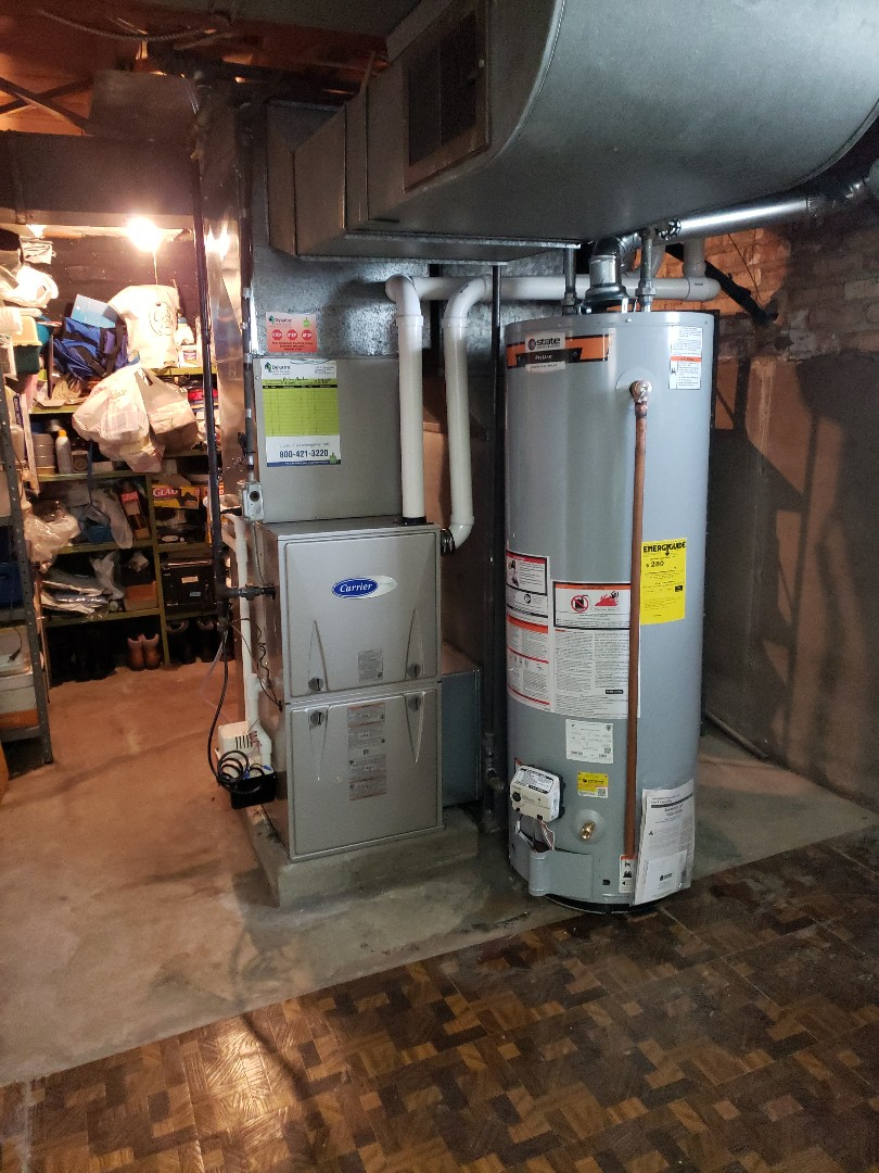 Chicago, IL - Carrier furnace and air conditioner installation with hot water tank