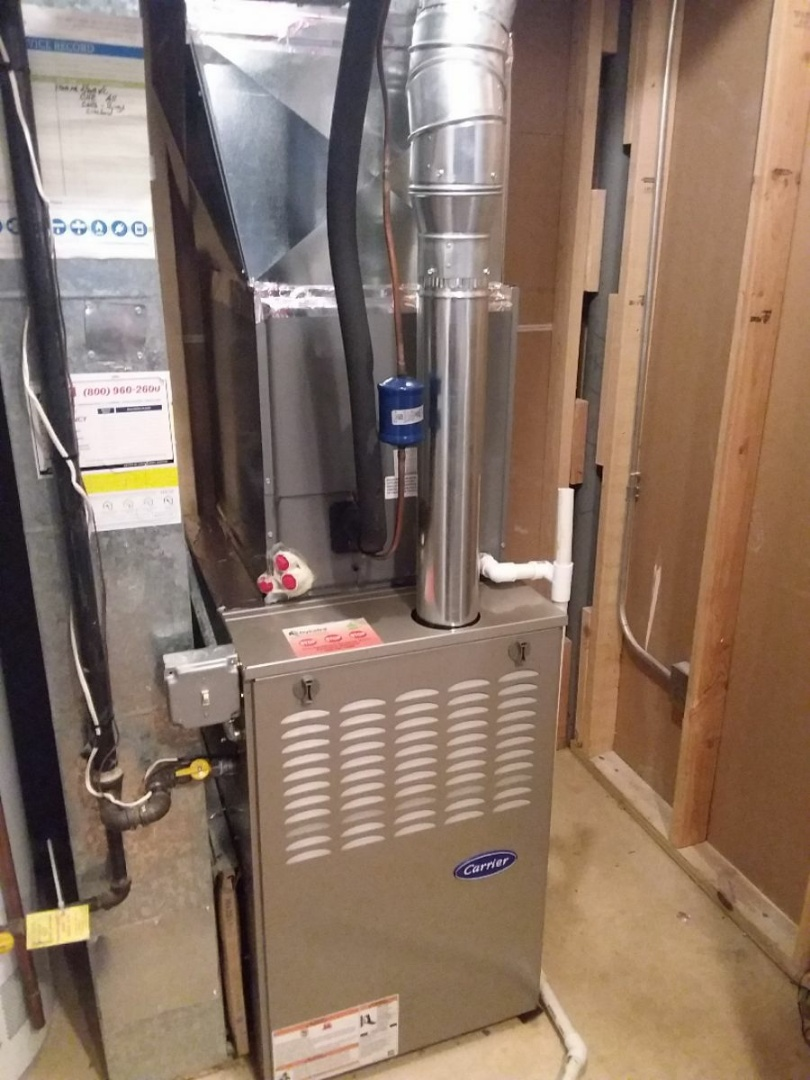 Bolingbrook, IL - Installing new carrier furnace replacing old lux air.