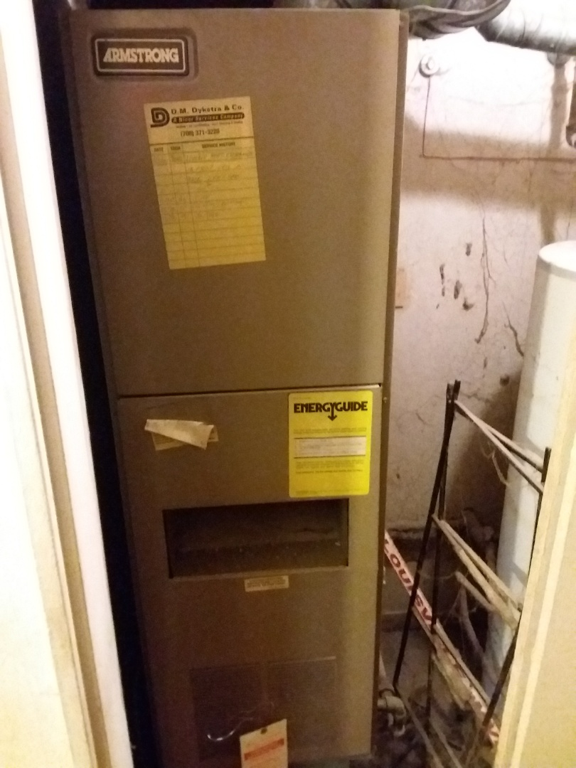 Markham, IL - Installing new carrier furnace replacing old Armstrong furnace.