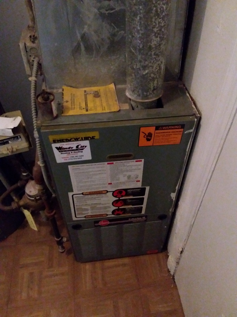 Chicago Heights, IL - Repairing a Rheem furnace