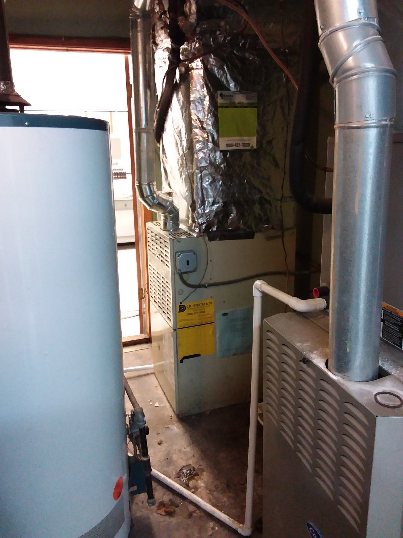Oak Lawn, IL - Carrier furnace installation in commercial store.