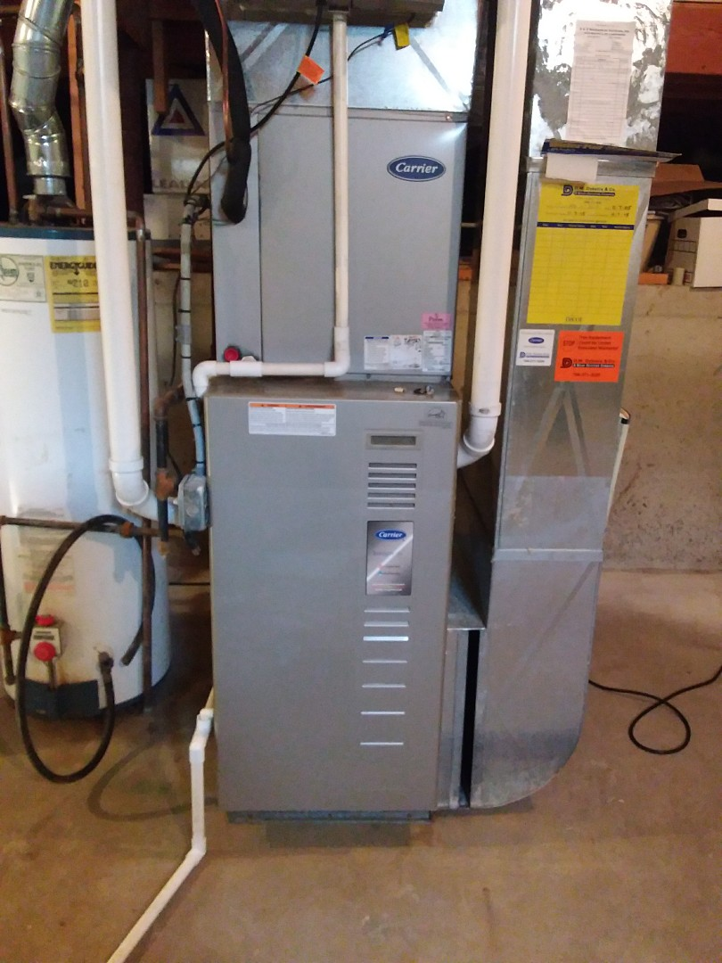 Lockport, IL - Installing new carrier furnace replacing old carrier furnace damaged in flood