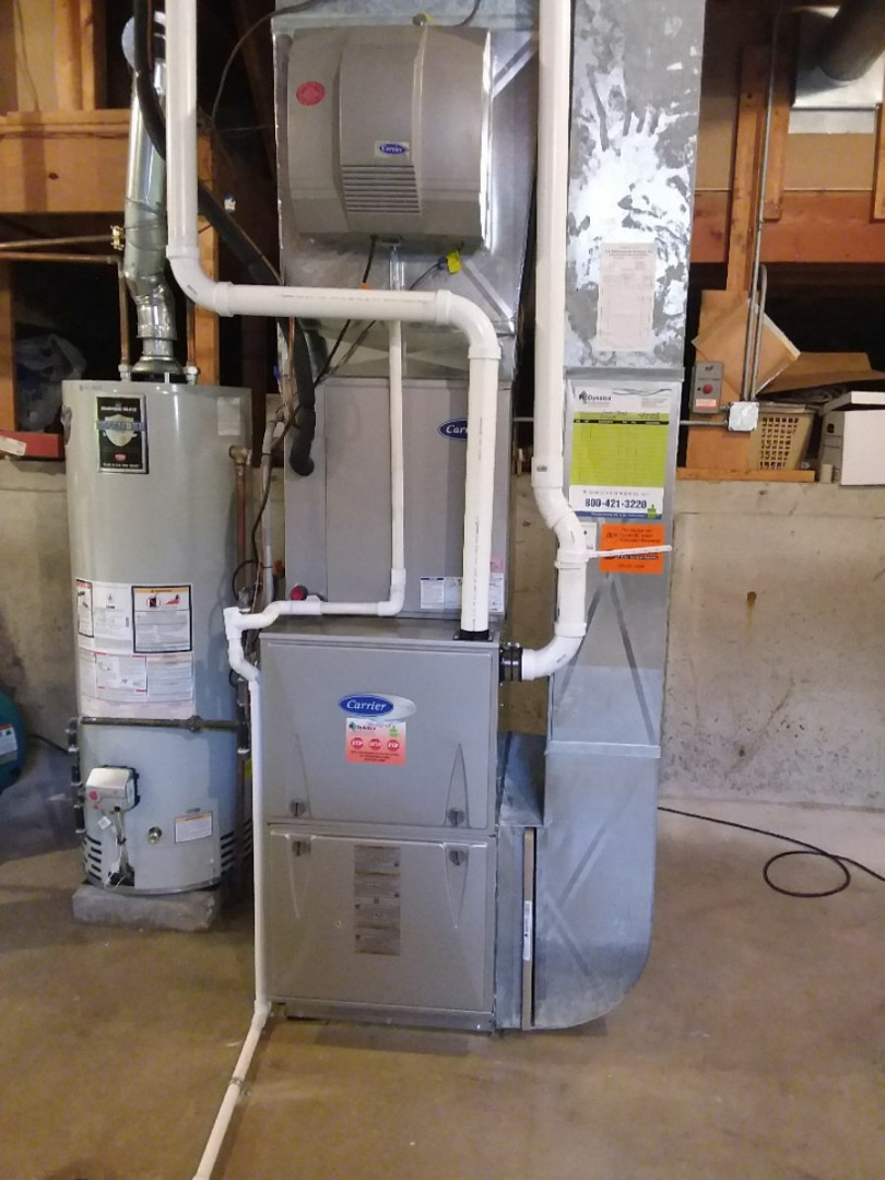 Lockport, IL - Installing new carrier furnace replacing old carrier furnace under 3 feet of water