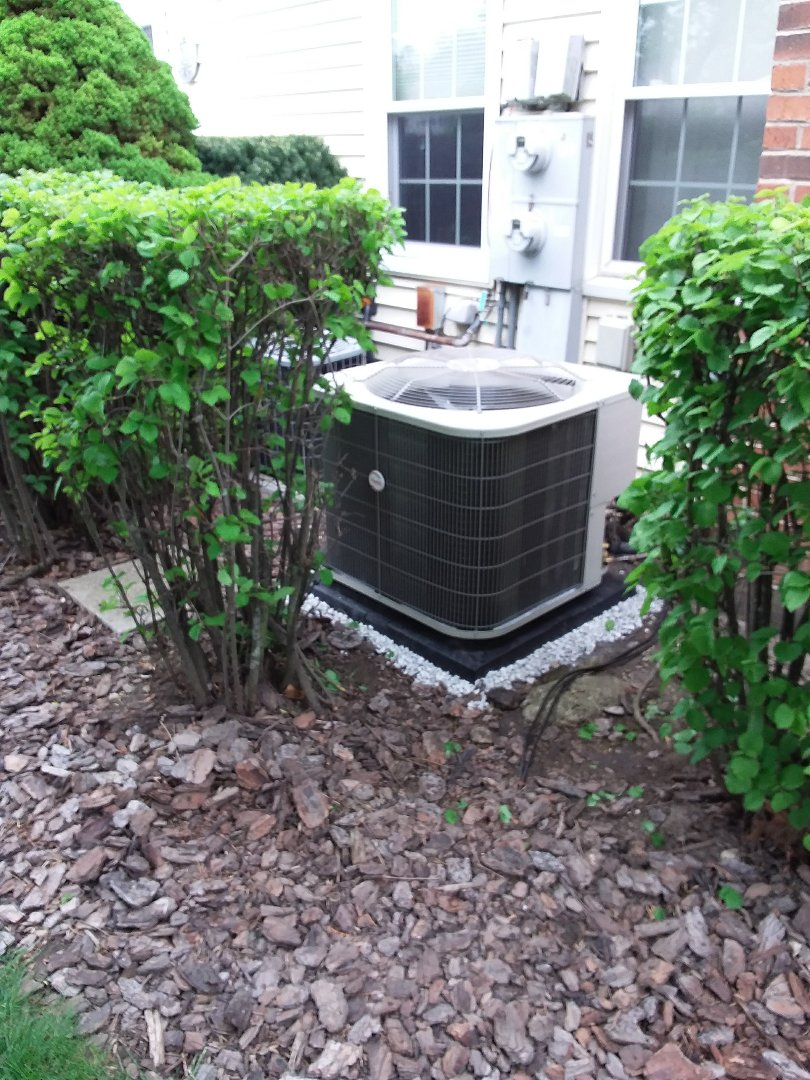 Warrenville, IL - Installation of new carrier air conditioner replacing old ge air conditioner