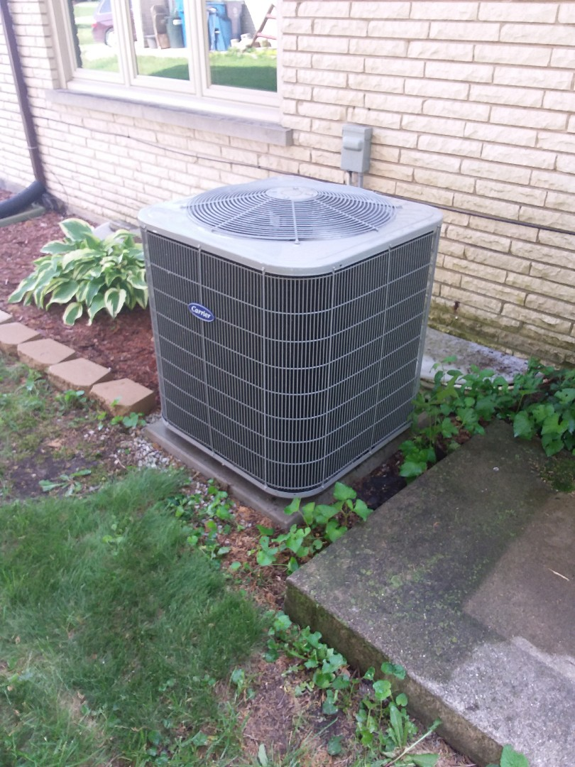 Palos Heights, IL - Maintained carrier furnace and Carrier AC unit