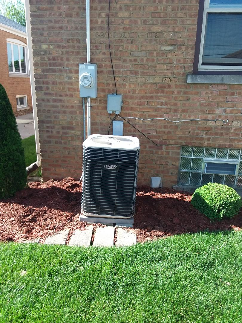 Evergreen Park, IL - Installation of carrier Infinity air conditioner replace old Lennox air conditioner