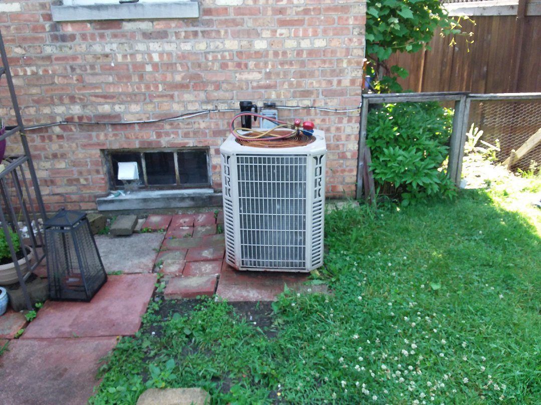 Elmwood Park, IL - Installation of new carrier air conditioner replacing old York air conditioner