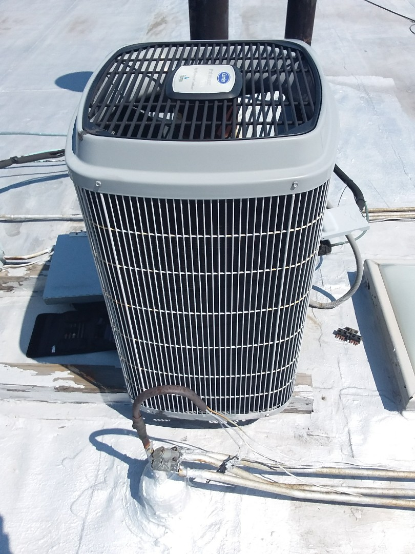 Oak Lawn, IL - Maintaining in Carrier AC unit