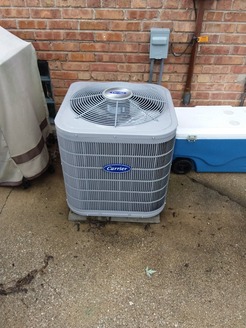Oak Lawn, IL - Maintaining and Carrier AC unit
