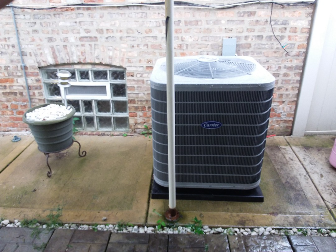 Maywood, IL - Installation of new carrier air conditioner replacing old ge air conditioner