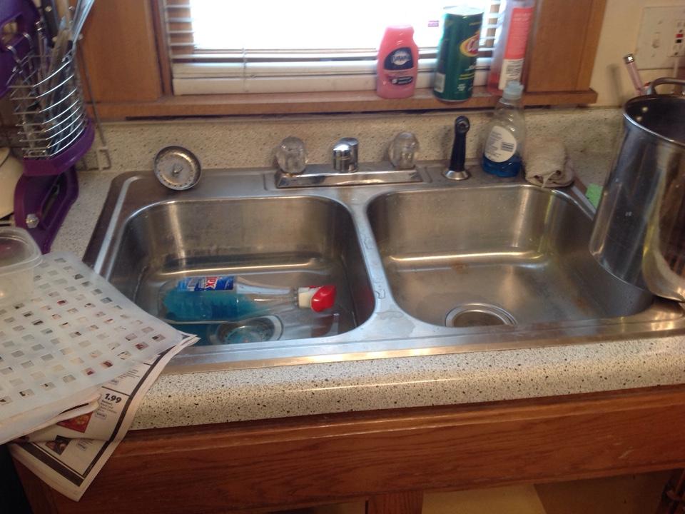 Minneapolis, MN - Snake kitchen drain