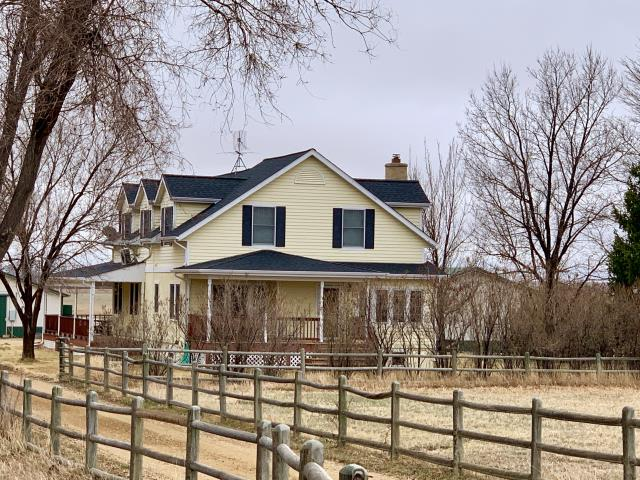 Platteville, CO - This farmhouse in Platteville/Mead has a gorgeous new roof.  We installed GAF Timberline HD shingles in the color Charcoal.