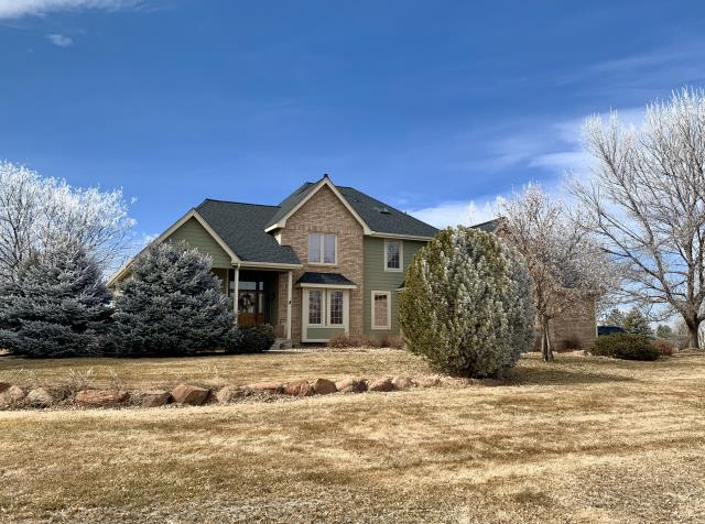 Mead, CO - We re-roofed this home in the Mulligan Lake neighborhood of Mead using GAF Timberline HD shingles in the color Charcoal.