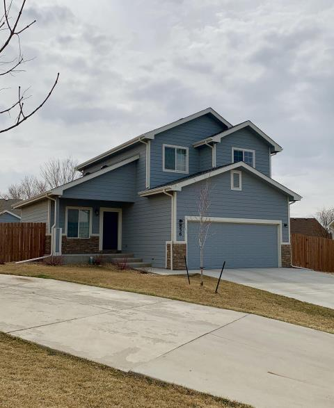 Firestone, CO - You can't see a lot of the roof of this house in Firestone from the street, but we installed a new GAF Timberline HD roof on there in the color Weathered Wood.