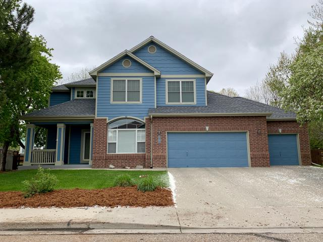 Longmont, CO - This is a home in south Longmont that we recently re-roofed.  We installed GAF Timberline HD shingles.  The color is Pewter Gray.  It goes really nice with the siding color and the brick on this home.
