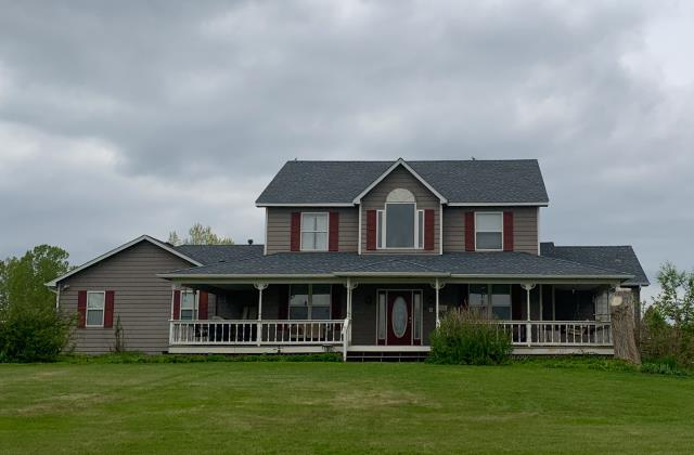 Mead, CO - This home in Mead has a new roof on it recently installed by us.  The shingles are GAF Timberline HD shingles in the color Pewter Gray.