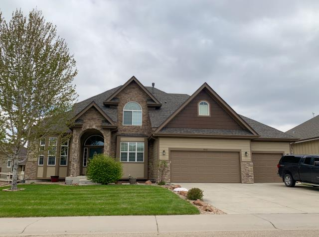 Firestone, CO - We re-roofed this home for a customer in Firestone and a rental the customer owns.  Both were hit with hail last summer.  The shingles we installed on this home are GAF Timberline HD shingles in Weathered Wood.