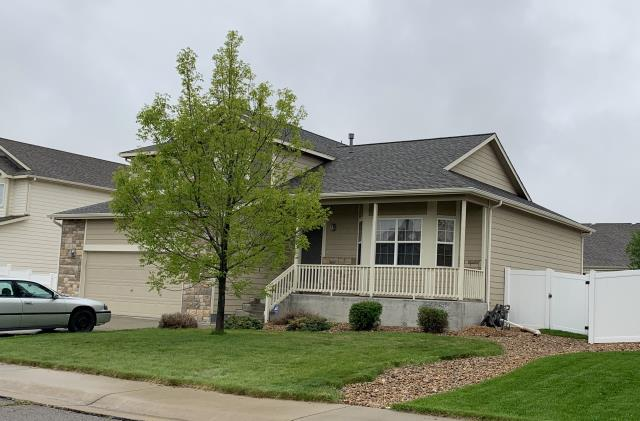 Mead, CO - We re-roofed this home in Mead that was hit with hail last summer using GAF Timberline HD shingles in the color Weathered Wood.