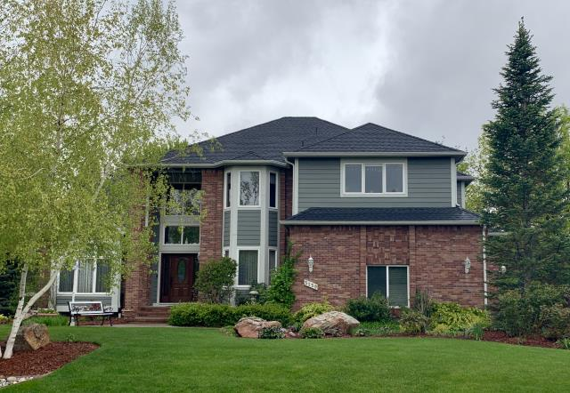 Longmont, CO - We re-roofed this home in Longmont that was hit with hail last summer, using GAF Timberline HD Ultra shingles in the color Charcoal.